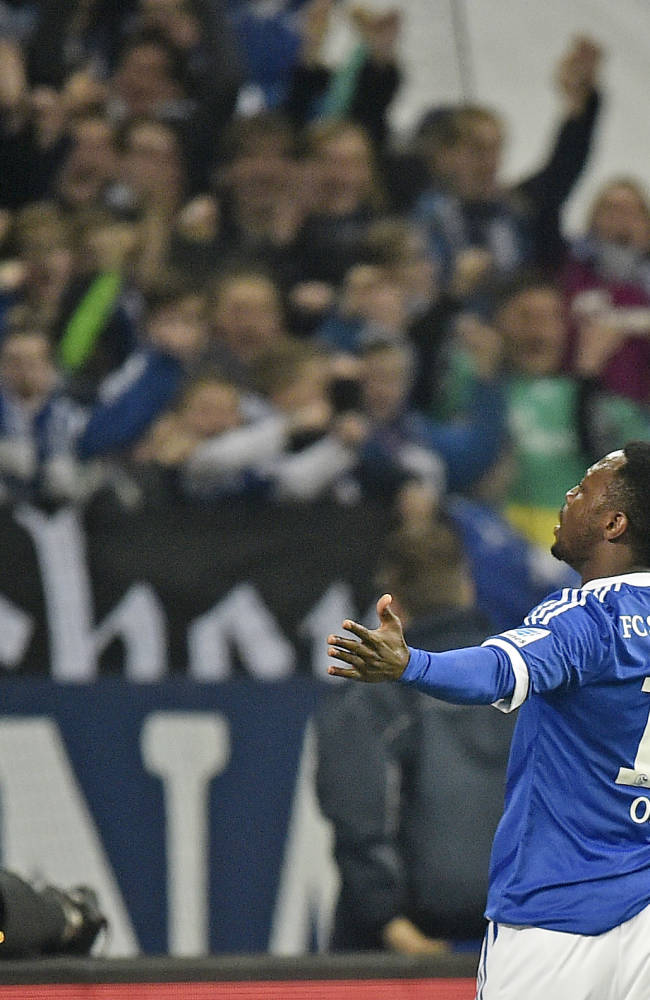 Schalke's Chinedu Obasi of Nigeria celebrates with supporters after scoring during  the German Bundesliga soccer match between FC Schalke 04 and Hertha BSC Berlin in Gelsenkirchen,  Germany, Friday, March 28, 2014