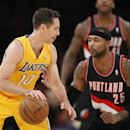 Los Angeles Lakers guard Steve Nash, left, dribbles the ball as Portland Trail Blazers guard Mo Williams defends during the first half of an NBA basketball game in Los Angeles, Tuesday, April 1, 2014 The Associated Press