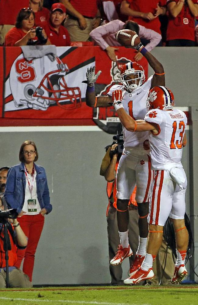 Clemson's Martavis Bryant (1) celebrates his touchdown catch with teammate Adam Humphries (13) during the second half of an NCAA college football game against  North Carolina State in Raleigh, N.C., Thursday, Sept. 19, 2013. Clemson won 26-14