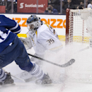 Nashville Predators goaltender Marek Mazanec, right, makes a save on Toronto Maple Leafs' James van Riemsdyk during the second period of an NHL hockey game, Thursday, Nov. 21, 2013 in Toronto The Associated Press