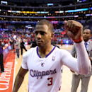 Chris Paul #3 of the Los Angeles Clippers celebrates as he leavies the court after defeating the Golden State Warriors in Game Seven of the Western Conference Quarterfinals during the 2014 NBA Playoffs at Staples Center on May 3, 2014 in Los Angeles, California. The Clippers won 126-121. (Photo by Stephen Dunn/Getty Images)