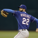 Moreland homers, Martinez pitches Rangers past A's 2-1 The Associated Press