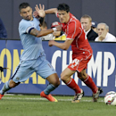 Manchester City's Aleksandar Kolarov (11) and Liverpool's Martin Kelly (34) fight for control of the ball in the first half of a Guinness International Champions Cup soccer tournament match Wednesday, July 30, 2014, in New York