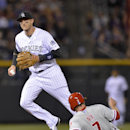 Colorado Rockies shortstop Troy Tulowitzki, left, forces out Philadelphia Phillies' Jayson Nix (7) at second to end the fifth inning of a baseball game on Friday, April 18, 2014, in Denver The Associated Press