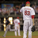 Philadelphia Phillies pitcher Jake Diekman (63) walks back to the mound after Atlanta Braves' Dan Uggla hit a grand slam in the ninth inning of a baseball game Monday, April 14, 2014, in Philadelphia. Atlanta won 9-6 The Associated Press