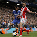 Chelsea's Ashley Cole, left, competes with Stoke City's Marc Wilson during their English Premier League soccer match at Stamford Bridge, London, Saturday, April 5, 2014