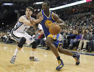 Golden State forward Harrison Barnes (40) drives to the basket against Memphis Grizzlies forward Mike Miller (13) in the first half of an NBA basketball game Saturday, Dec. 7, 2013, in Memphis, Tenn. (AP Photo/Lance Murphey)