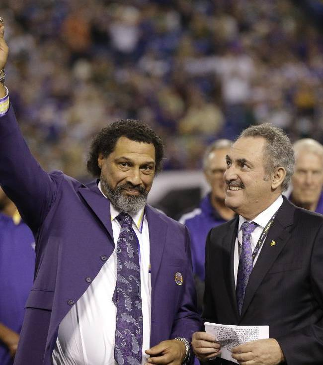 Former Vikings safety Joey Browner receives the ring of honor by Zygi Wilf, the majority owner of the team, during the halftime an NFL football game between the Minnesota Vikings and the Green Bay Packers, Sunday, Oct. 27, 2013, in Minneapolis