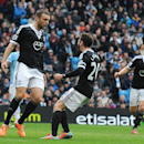 Southampton's Rickie Lambert, left, celebrates scoring from the penalty spot against Manchester City with teammate Adam Lallana during the English Premier League soccer match between Manchester City and Southampton at The Etihad Stadium, Manchester, Engla