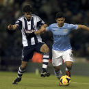 Manchester City's Sergio Aguero, right, tussles for ball with West Bromwich Albion's Claudio Yacob during the English Premier League soccer match at The Hawthorns, West Bromwich, England, Wednesday Dec. 4, 2013. Manchester City won the match 2-3