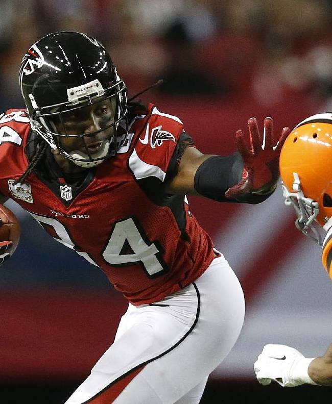 Atlanta Falcons wide receiver Roddy White (84) runs by Cleveland Browns cornerback Justin Gilbert (21) during the second half of an NFL football game, Sunday, Nov. 23, 2014, in Atlanta