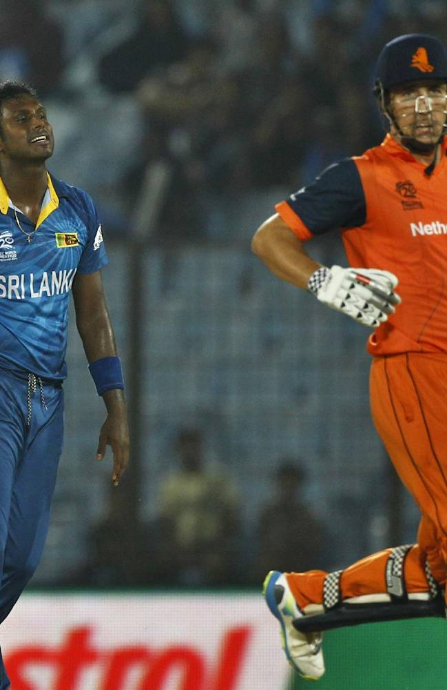 Sri Lanka's Ajantha Mendis, left, celebrates the wicket of Netherlands's Tom Cooper, right, during their ICC Twenty20 Cricket World Cup match in Chittagong, Bangladesh, Monday, March 24, 2014