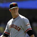 San Francisco Giants starting pitcher Matt Cain looks up at the score board walking back to the dugout after being removed in the sixth inning of a baseball game against the Los Angeles Dodgers on Saturday, May 10, 2014, in Los Angeles. (AP Photo/Alex Gallardo)