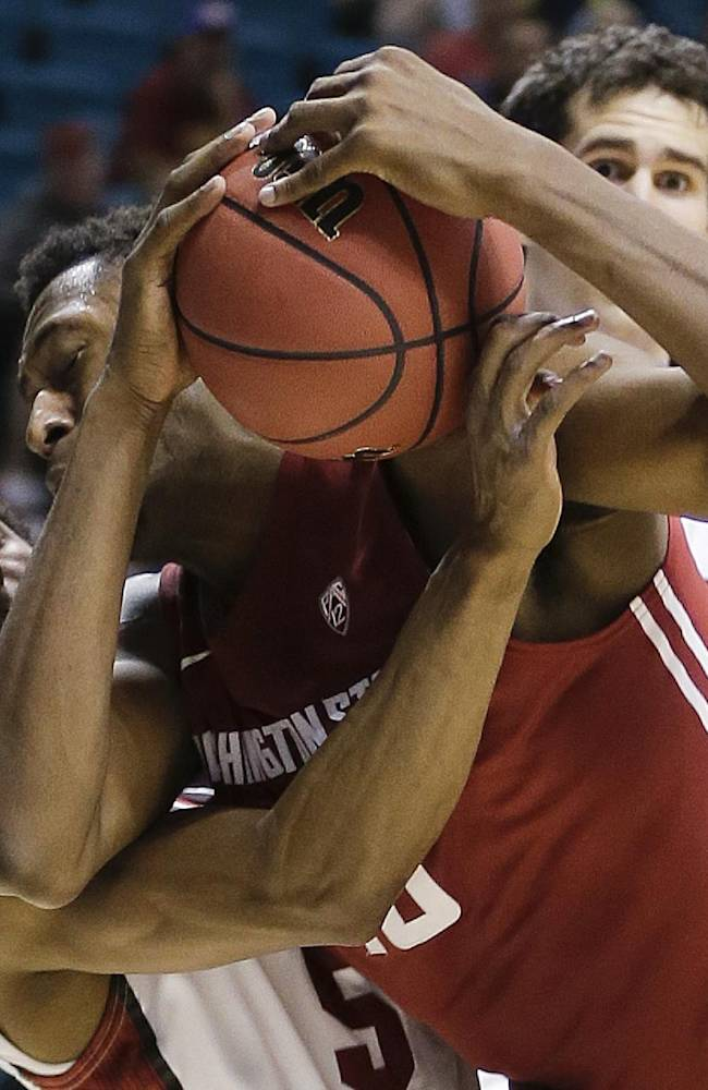 Stanford's Chasson Randle, left, gets tangled up with Washington State's Junior Longrus as they vie for a rebound in the second half of an NCAA Pac-12 conference tournament college basketball game, Wednesday, March 12, 2014, in Las Vegas. Stanford won 74-63