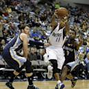 Dallas Mavericks' Monta Ellis (11) gets by Memphis Grizzlies' Mike Miller, left, and Tony Allen (9) on a drive to the basket in the first half of an NBA basketball game on Wednesday, Dec. 18, 2013, in Dallas. (AP Photo/Tony Gutierrez)