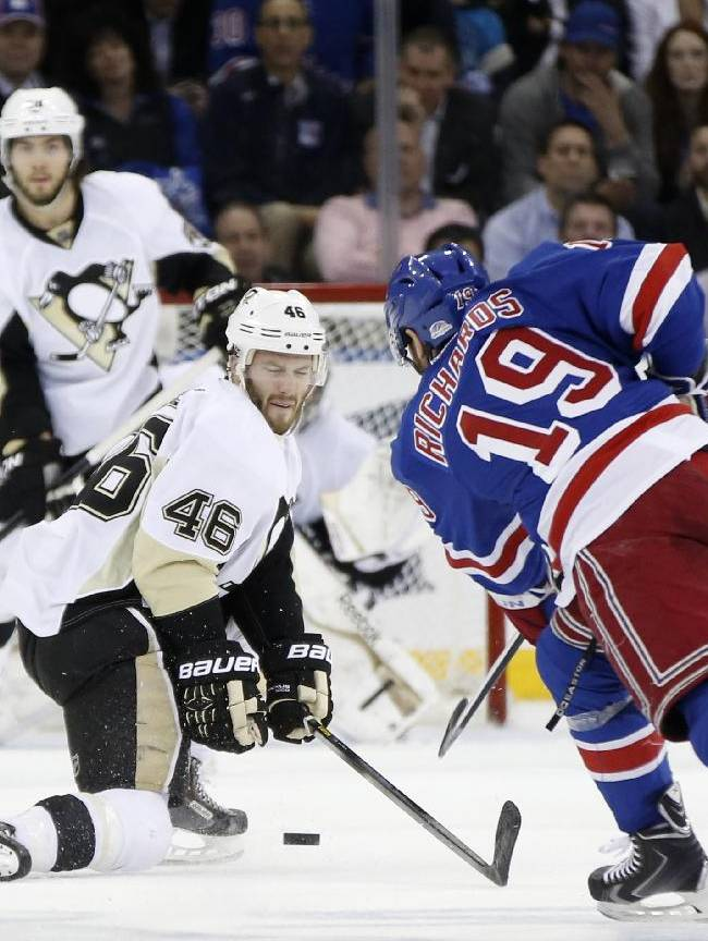 New York Rangers center Brad Richards (19) takes a shot as Pittsburgh Penguins center Joe Vitale (46) defends in the third period of their second-round NHL Stanley Cup hockey playoff game at Madison Square Garden in New York, Monday, May 5, 2014.  The Penguins shutout the Rangers 2-0 to take a 2-1 lead in the series