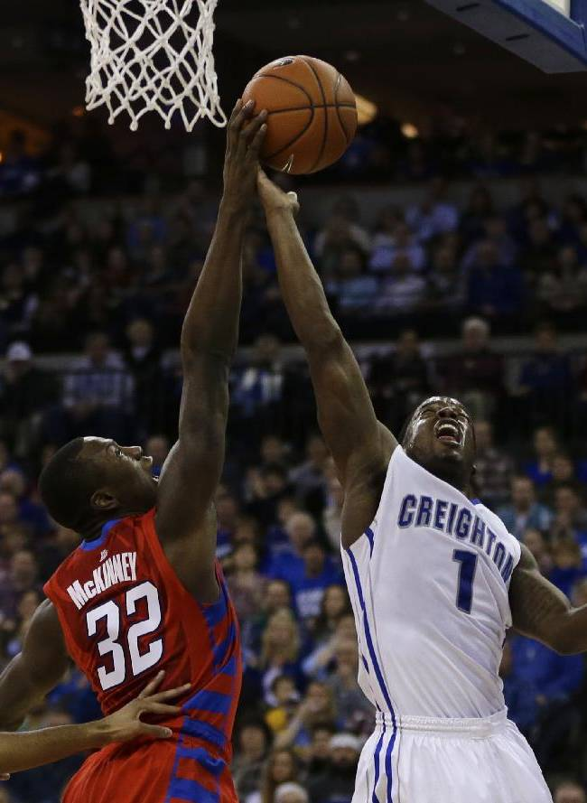 DePaul's Charles McKinney (32) blocks a shot by Creighton's Austin Chatman (1) in the first half of an NCAA college basketball game in Omaha, Neb., Friday, Feb. 7, 2014