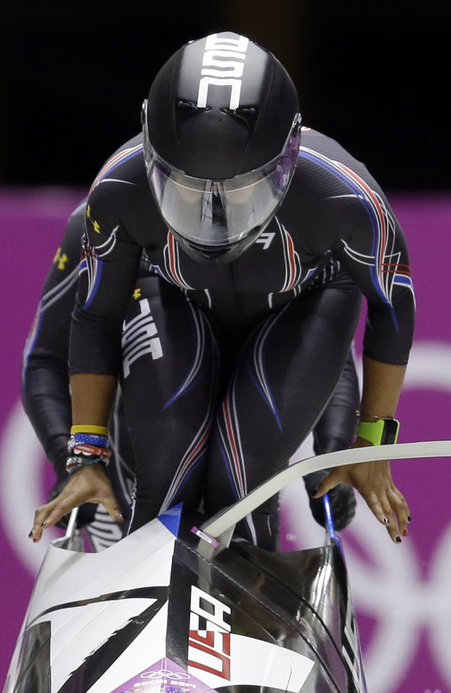 The team from the United States USA-3, piloted by Jazmine Fenlator with brakeman Lolo Jones, start their third run during the women's bobsled competition at the 2014 Winter Olympics, Wednesday, Feb. 19, 2014, in Krasnaya Polyana, Russia