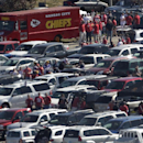Kansas City Chiefs fans gather in the parking lot at Arrowhead Stadium before an NFL football game against the Minnesota Vikings Sunday, Oct. 2, 2011 in Kansas City, Mo. (AP Photo/Charlie Riedel)