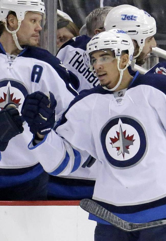 Winnipeg Jets' Evander Kane (9) celebrates his second goal of the second period during an NHL hockey game against the Pittsburgh Penguins in Pittsburgh Sunday, Jan. 5, 2014