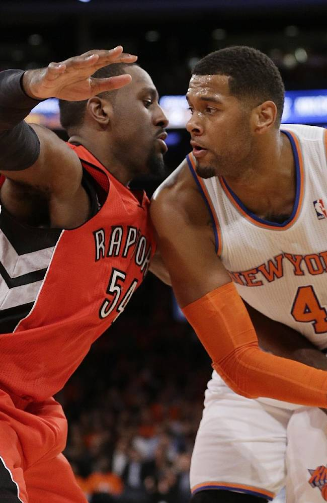 Toronto Raptors' Patrick Patterson (54) defends New York Knicks' Jeremy Tyler (4) during the first half of an NBA basketball game Wednesday, April 16, 2014, in New York