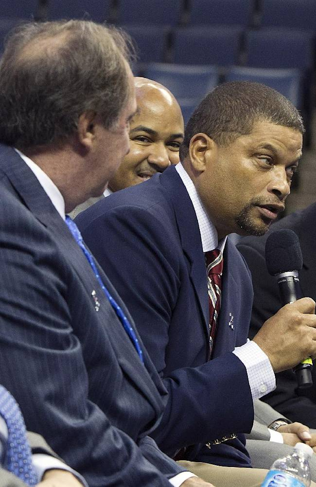 Rutgers coach Eddie Jordan, center, answers questions atthe American Athletic Conference NCAA college basketball media day on Wednesday, Oct. 16, 2013, in Memphis, Tenn