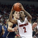 Louisville's Russ Smith (2) drives around the defense of Pittsburgh's Steven Adams during the second half of their NCAA college basketball game, Monday, Jan. 28, 2013, in Louisville, Ky. Louisville won 64-61. (AP Photo/Timothy D. Easley)