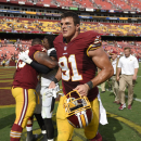 FILE - In this Sept. 14, 2014, file photo, Washington Redskins outside linebacker Ryan Kerrigan (91) runs off the field after an NFL football game against the Jacksonville Jaguars in Landover, Md. The Redskins agreed to a multiyear contract extension with Kerrigan on Wednesday, July 29, 2015, a day before the first practice of training camp. The Redskins announced the deal a few hours before coach Jay Gruden was scheduled to speak to reporters at the team's camp facility. (AP Photo/Nick Wass, FIle)