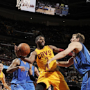 CLEVELAND, OH - OCTOBER 17: Kyrie Irving #2 of the Cleveland Cavaliers passes to a teammate from under the basket against Dirk Nowitzki #41 of the Dallas Mavericks at The Quicken Loans Arena on October 17, 2014 in Cleveland, Ohio. (Photo by David Liam Kyle/NBAE via Getty Images)