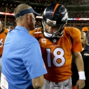 Denver Broncos quarterback Peyton Manning (18) greets San Diego Chargers coach Mike McCoy after an NFL football game, Thursday, Oct. 23, 2014, in Denver. The Broncos won 35-21 The Associated Press