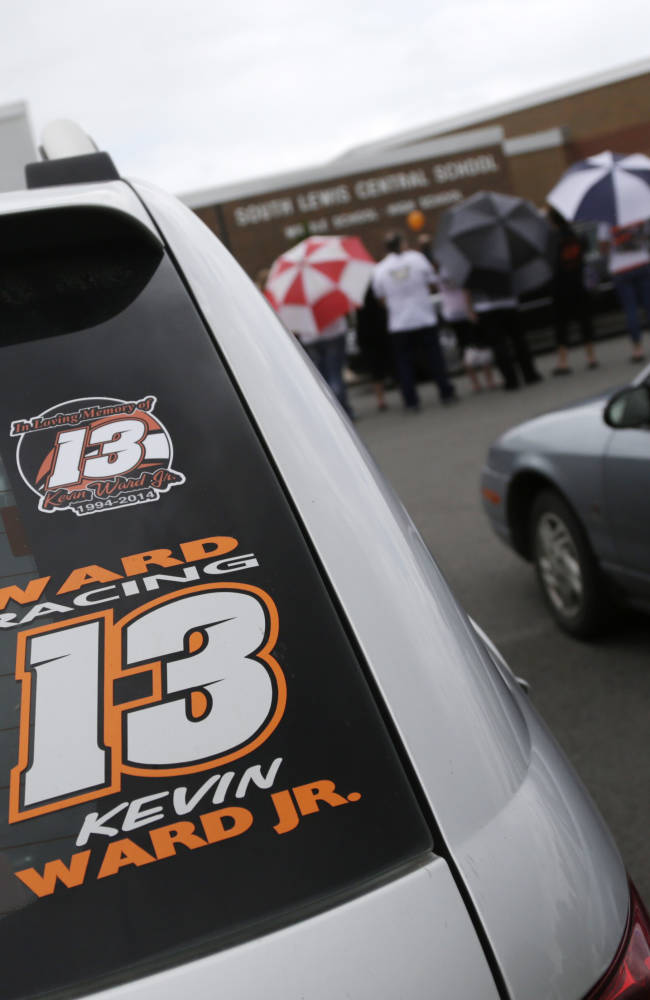 A Kevin Ward Jr. racing sticker is displayed on a vehicle outside South Lewis Central School after a funeral on Thursday, Aug. 14, 2014, in Turin, N.Y. Ward died after being struck by NASCAR driver Tony Stewart's car during a race last weekend at a dirt track in western New York. (AP Photo/Mike Groll)
