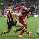 Hull City's Shane Long, left, and West Bromwich Albion's Stephane Sessegnon in action during their English Premier League soccer match at the KC Stadium, in Hull, England, Saturday March 22, 2014. (AP Photo / Anna Gowthorpe, PA)