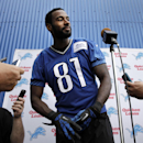 Detroit Lions wide receiver Calvin Johnson takes questions from the media after an NFL football training camp in Allen Park, Mich., Tuesday, July 29, 2014 The Associated Press
