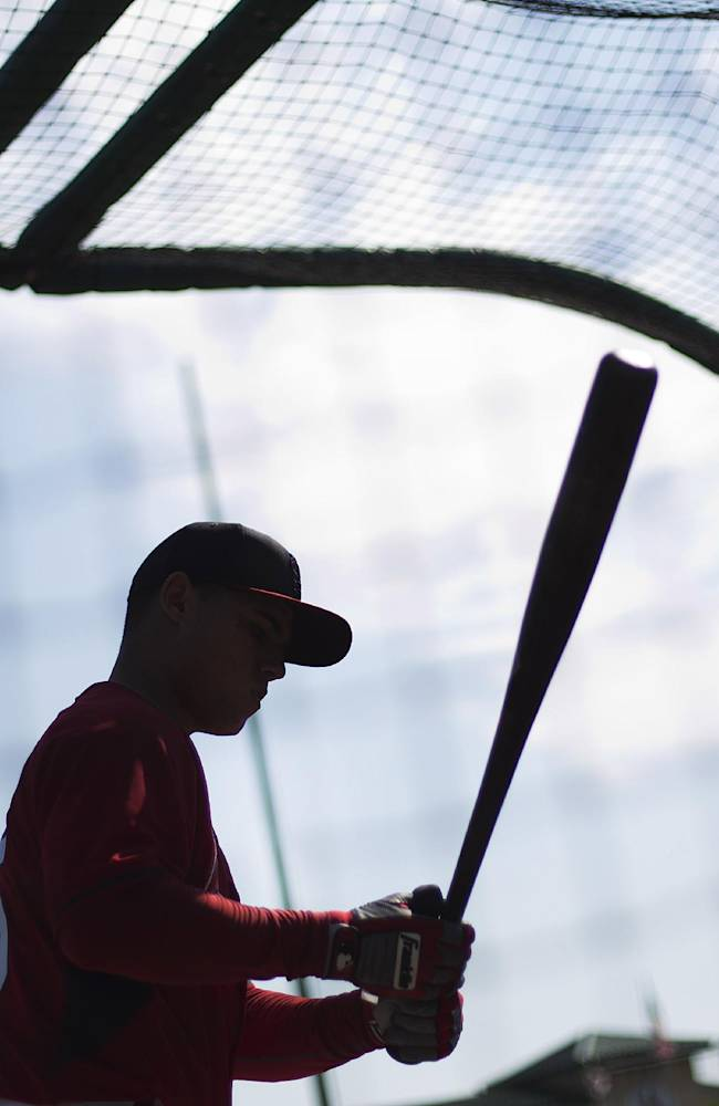 St. Louis Cardinals' Aledmys Diaz takes batting practice before the start of an exhibition spring training baseball game against the Detroit Tigers, Monday, March 10, 2014, in Jupiter, Fla. Diaz reported to spring training Monday after the Cardinals signed the Cuban free agent shortstop to a major league contract. The Cardinals were among a number of teams, including the Yankees, who held private workouts for the right-handed hitting Diaz and the deal is believed to be for $15-20 million for four years