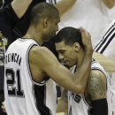 San Antonio Spurs' Tim Duncan (21) embraces Danny Green during the second half at Game 5 of the NBA Finals basketball series, against the Miami Heat, Sunday, June 16, 2013, in San Antonio. (AP Photo/David J. Phillip)