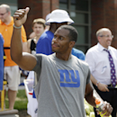 New York Giants' Victor Cruz responds to a fan after practice during a NFL football camp in East Rutherford, N.J., Wednesday, July 23, 2014 The Associated Press