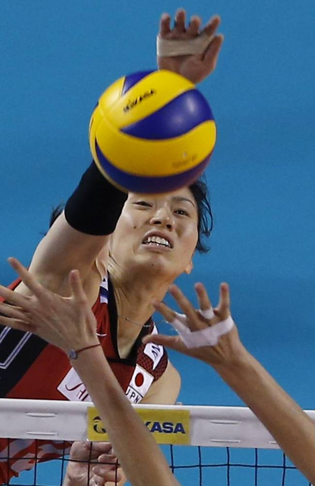 Japan's Risa Shinnabe spikes the ball against Russia's Tatiana Kosheleva during the final round of the Women's Volleyball World Grand Prix in Tokyo, Wednesday, Aug. 20, 2014