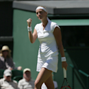 Petra Kvitova of the Czech Republic celebrates defeating Kiki Bertens of the Netherlands in their singles first round match at the All England Lawn Tennis Championships in Wimbledon, London, Tuesday June 30, 2015. Kvitova won the match 6-1, 6-0. (AP Photo/Tim Ireland)