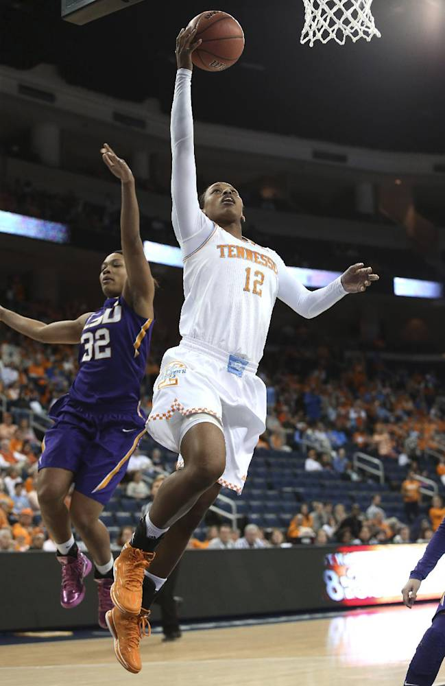 Tennessee forward Bashaara Graves (12) goes up for a basket against LSU guard Danielle Ballard (32) during the first half in an NCAA college basketball game in the quarterfinals of the Southeastern Conference women's tournament, Friday, March 7, 2014, in Duluth, Ga
