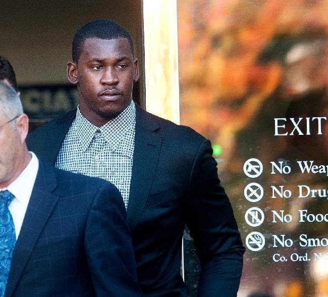 Accompanied by his attorney Joshua Bentley, left, San Francisco 49ers linebacker Aldon Smith leaves an arraignment at Santa Clara County Superior Court on Tuesday, Nov, 12, 2013, in San Jose, Calif. Smith faces three felony counts of illegal possession of an automatic weapon stemming from a party at his home in June 2012