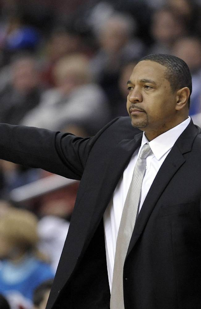 Golden State Warriors head coach Mark Jackson points to his players during the second half of an NBA basketball game against the Philadelphia 76ers on Monday, Nov. 4, 2013, in Philadelphia. The Warriors won 110-90