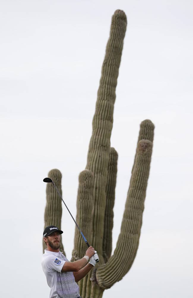 Graham DeLaet, of Canada, hits his tee shot on the fourth hole during the first round of the Match Play Championship golf tournament on Wednesday, Feb. 19, 2014, in Marana, Ariz
