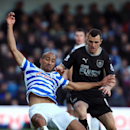 Queens Park Rangers' Karl Henry, left, and Burnley's Dean Marney battle for the ball during the English Premier League soccer match at Loftus Road, London, Saturday Dec. 6, 2014
