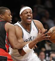 Toronto Raptors guard Kyle Lowry (7) gets tangled up with Brooklyn Nets forward Paul Pierce, right, in the first half of an NBA basketball game, Monday, Jan. 27, 2014, in New York. (AP Photo/Kathy Willens)