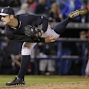 New York Yankees relief pitcher David Robertson follows through on a fourth-inning pitch against the Philadelphia Phillies in an exhibition baseball game in Tampa, Fla., Tuesday, March 25, 2014 The Associated Press