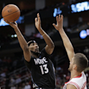 Minnesota Timberwolves forward Corey Brewer (13) shoots over Houston Rockets forward Chandler Parsons (25) during the first quarter of an NBA basketball game, Tuesday, March 20, 2014, in Houston The Associated Press