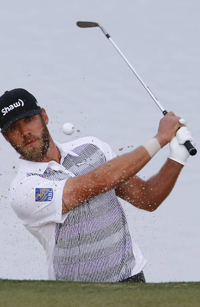 Graham DeLaet, of Canada, watches his sand shot on the third hole in his match against Patrick Reed during the first round of the Match Play Championship golf tournament on Wednesday, Feb. 19, 2014, in Marana, Ariz