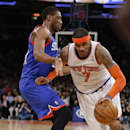 New York Knicks' Carmelo Anthony (7) drives past Philadelphia 76ers' Thaddeus Young (21) during the first half of an NBA basketball game Monday, March 10, 2014, in New York The Associated Press