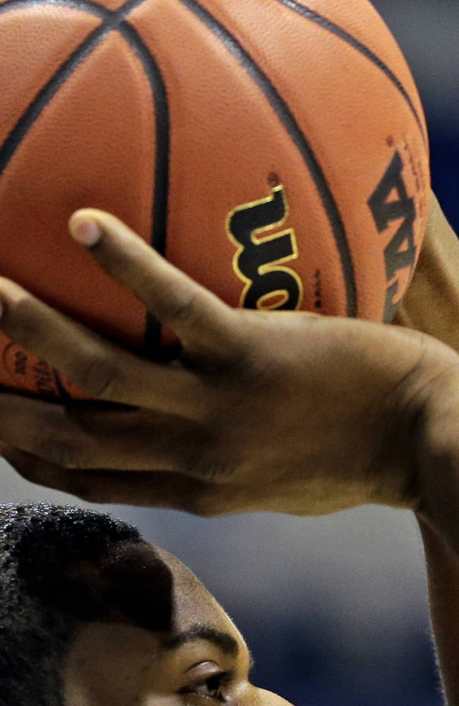 Michigan's Glenn Robinson III shoots during practice for their NCAA Midwest Regional semifinal college basketball tournament game Thursday, March 27, 2014, in Indianapolis. Michigan plays Tennessee on Friday, March 28, 2013. (AP Photo/Michael Conroy)