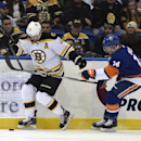 New York Islanders defenseman Thomas Hickey (14) tries to overtake Boston Bruins center David Krejci (46) during the first period of an NHL hockey game at Nassau Coliseum on Thursday, Jan. 29, 2015, in Uniondale, N.Y. The Bruins won 5-2 The Associated Pre